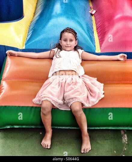 Girl on bouncy castle - Stock Image