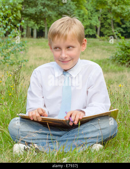 Boy with a sly look on his face - Stock Image