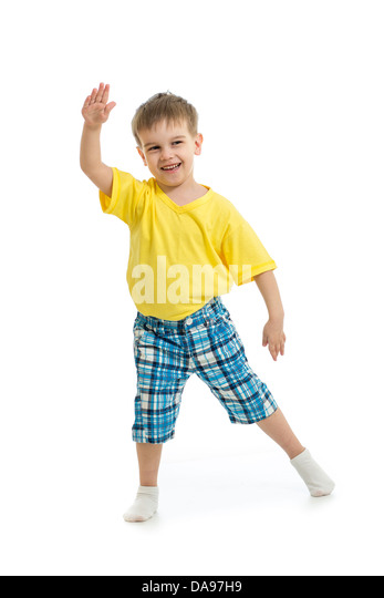 Funny kid boy dancing isolated on white - Stock Image