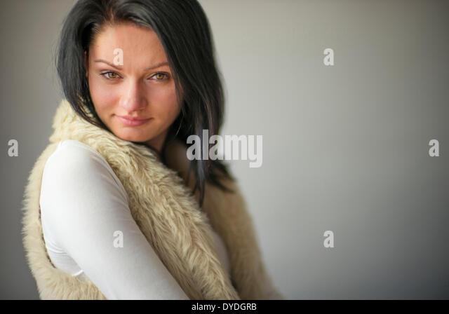 Beautiful woman with hazel eyes in the studio. - Stock Image