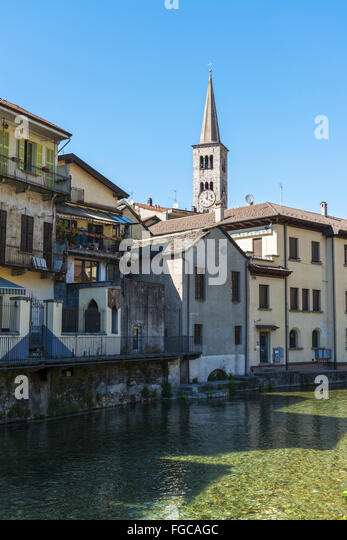foreshortening of Omegna, between houses and the river with blue sky background - Piedmont, Italy - Stock Image