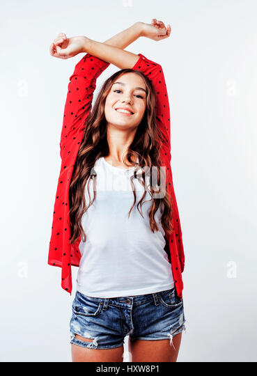 young pretty stylish hipster girl posing emotional isolated on white background happy smiling cool smile, lifestyle - Stock Image