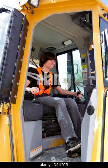 Nevada Las Vegas Dig This hands on hands-on bulldozer excavator construction equipment cab teen boy operating - Stock Image