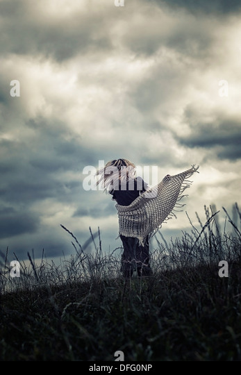 a girl is running on a meadow - Stock Image