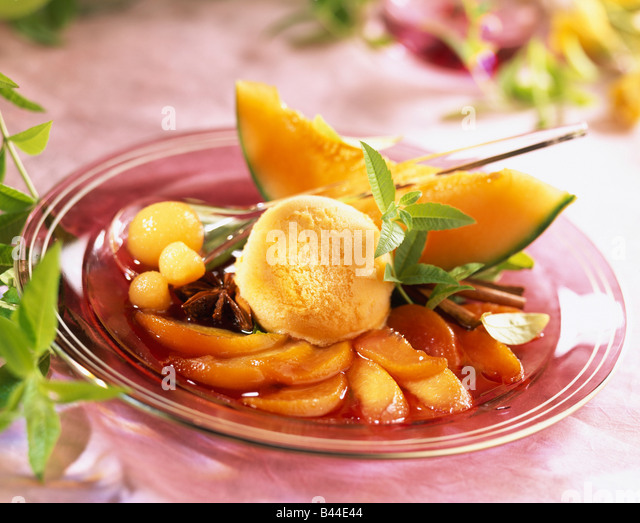 Carpaccio of peaches poached in wine and spices with melon sorbet ...