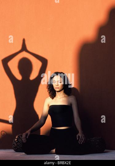 Girl doing meditation, Thailand - Stock Image
