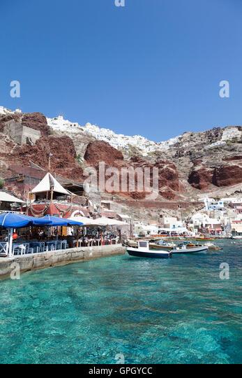 Boats in harbor at Eloudi bay, Santorini - Stock Image