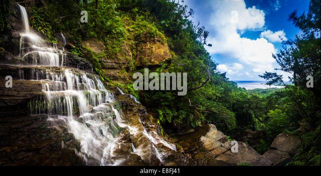 Waterfalls over rocks, Okinawa, Japan - Stock Image