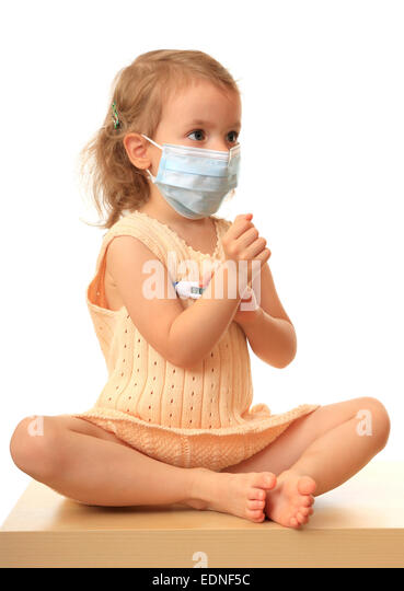 Girl is in a medical mask with a thermometer. - Stock Image