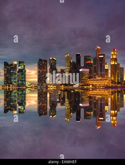 View of Singapore city skyline at sunset - Stock Image