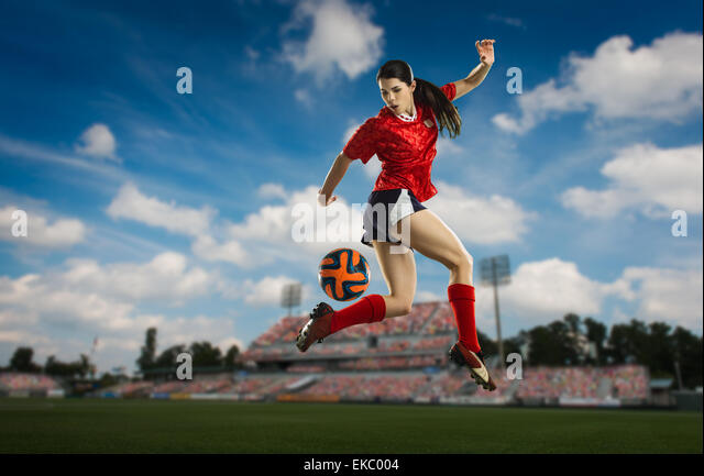Footballer trying back heel - Stock Image