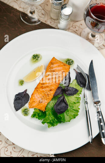 Grilled salmon on plate - Stock-Bilder