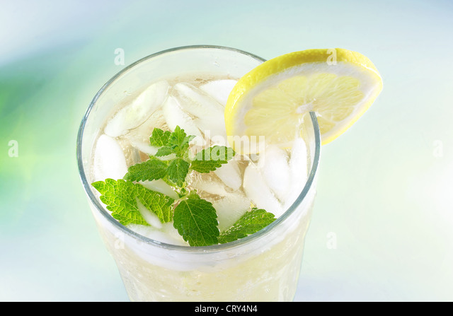 Ice-cold Lemonade with fresh slice of lemon and lemon balm (mint) - Stock Image