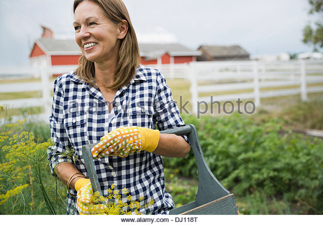Woman standing in garden - Stock Image