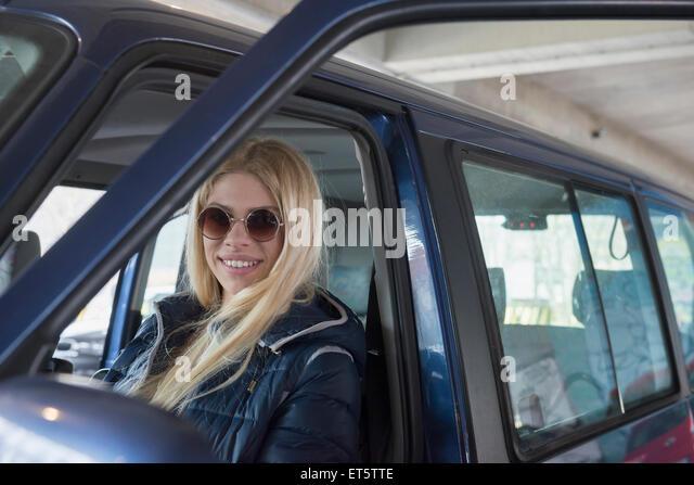 Teenage girl sitting in van, Munich, Bavaria, Germany - Stock Image