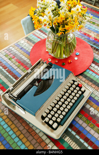 Vintage Blue Typewriter on a table - Stock Image