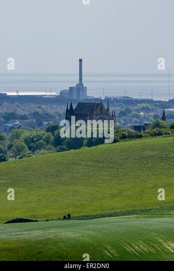 Lancing college as seen from the south downs contrasting with the modern    Shoreham Power Station - Stock Image