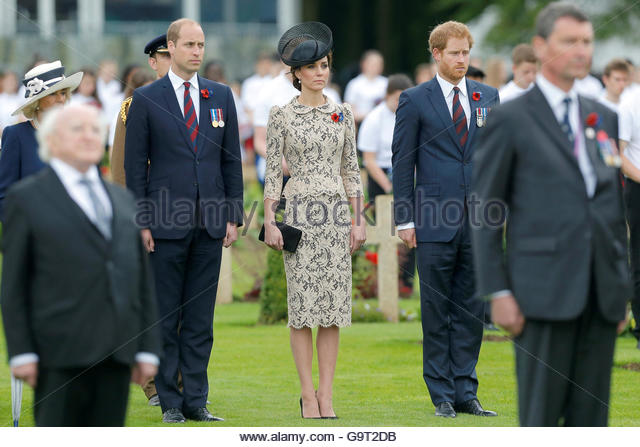Britain's Prince William (L) and his wife Catherine, the Duchess of Cambridge, and Prince Harry (R) attend a - Stock-Bilder