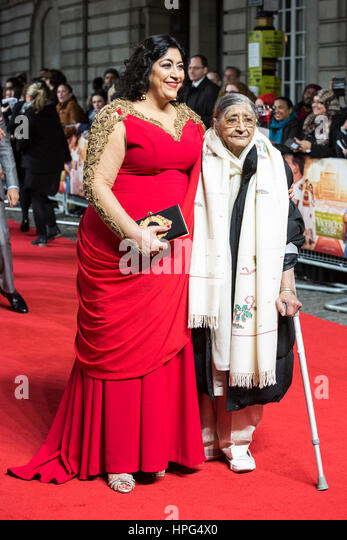 London, UK. 21 February 2017. Film director Gurinder Chadha with her mother. Red carpet arrivals for the UK premiere - Stock Image