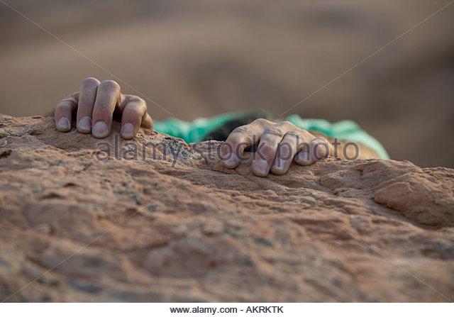 Hands of a rock climber - Stock Image