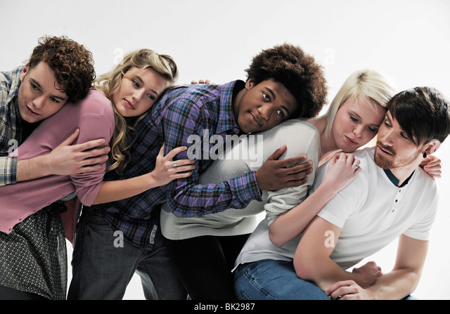 5 young people supporting each other - Stock Image