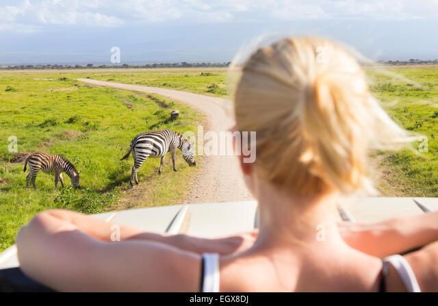 Woman on african wildlife safari. - Stock Image