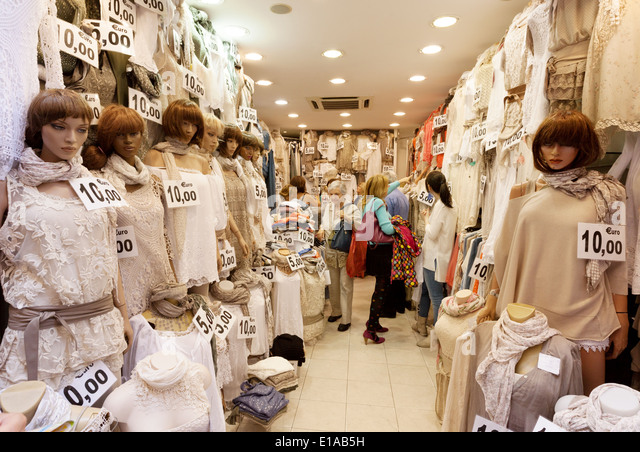 Women shopping in a cheap lace clothes shop, Rome Italy Europe - Stock Image