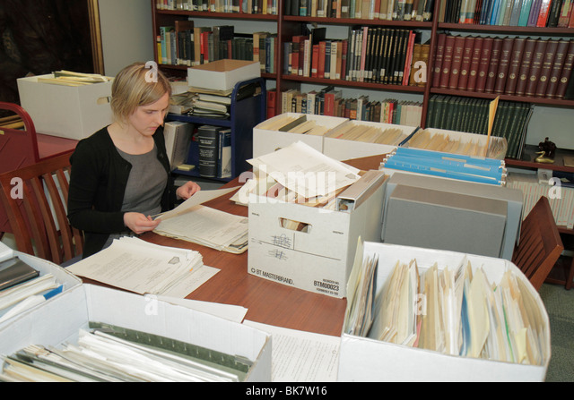 Washington DC 14th Street NW National Press Club National Journalism Library archivist intern archives woman desk - Stock Image
