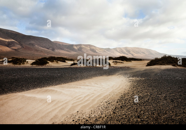 Sand and landscape of Famara beach, Canary Islands, Spain - Stock Image