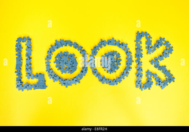 The word look spelled out in jigsaw pieces - Stock Image