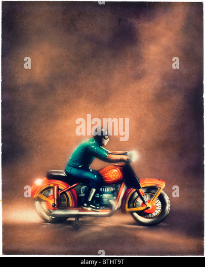 old tin toy motorcycle with rider. Polaroid transfer - Stock Image