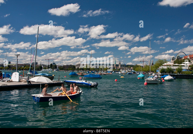 rowboat at Zurich lake in summer Zuerich Switzerland - Stock Image