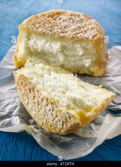 Farm goats cheese from Normandy against a blue background - Stock Image