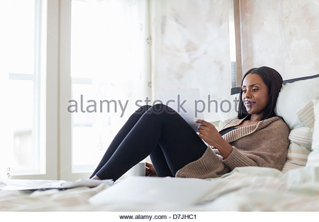 Woman with coffee working from home - Stock Image