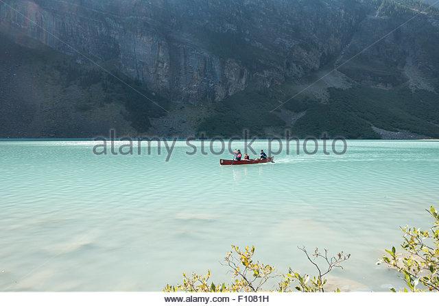 Canoeing on lake Louise, Canadian Rockies. - Stock Image