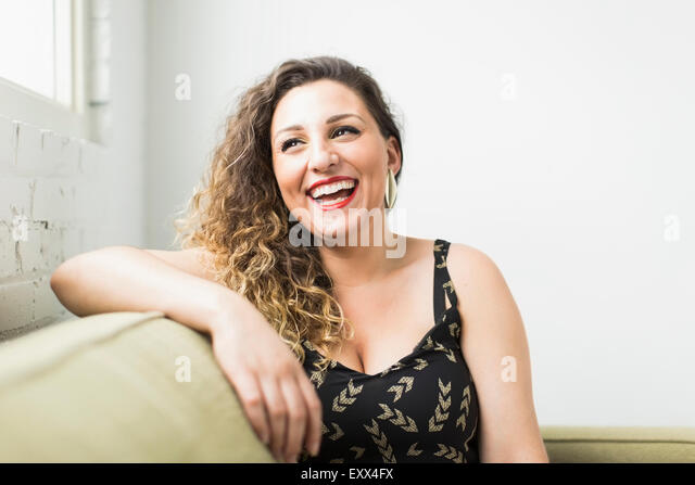 Woman looking away and laughing - Stock-Bilder