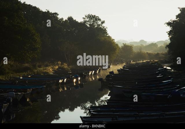 Killarney, County Kerry, Ireland; Boats Moored Along The Shore Of Lough Leane - Stock Image