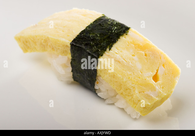 tamago egg sushi fresh white yellow seaweed rice rapped appetizer meal Asian consumption eat food - Stock Image
