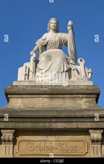 'Seefahrt und Handel' statue, 'seafaring and trade', on a sandstone pillar, Mainz castle gate, lettering - Stock Image