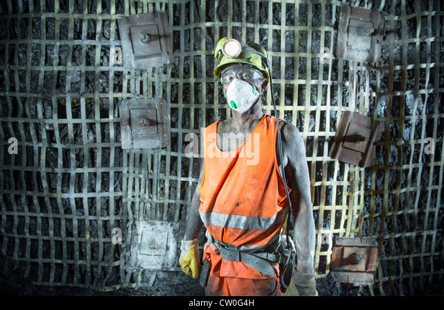 Coal miner standing in mine - Stock Image