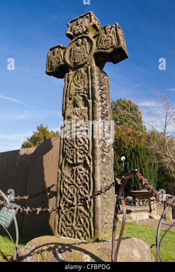 Saxon preaching cross, Eyam, Derbyshire, England UK - Stock Image
