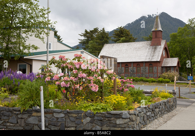 Flower garden outside St. Gregory Catholic Church in Sitka, Alaska - Stock Image