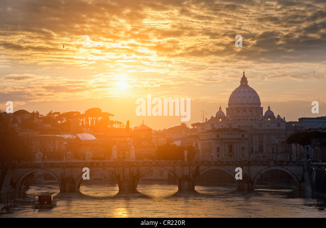 St Peters Basilica and bridge on canal - Stock Image