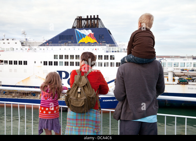 A family with children going on holiday by ferry travel, Dover to Calais channel crossing, England to France, at - Stock-Bilder