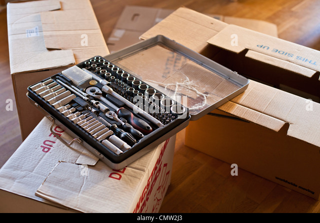 Tool box on cardboard box - Stock Image