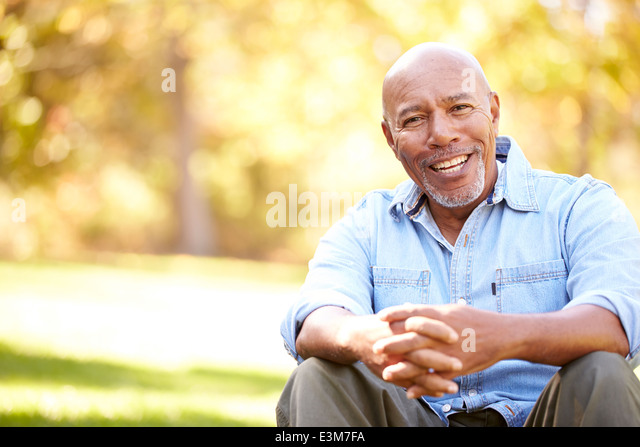 Senior Man Relaxing In Autumn Landscape - Stock Image