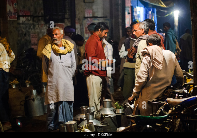Indian men at Milk Market, Varanasi India - Stock-Bilder