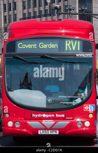 A hydrogen powered bus in London with Tower Bridge reflecting in the windscreen, England. - Stock Image
