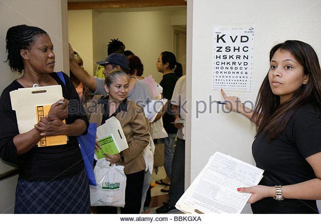 Miami Florida Liberty City Jessie Trice Community Health Center fair free care exam volunteer Black Hispanic woman - Stock Image