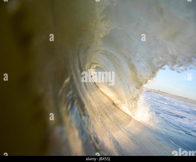 Close up surface level view of rolling wave and beach, Laguna Beach, California, USA - Stock-Bilder